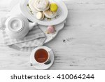cup of tea with macaroons on... | Shutterstock . vector #410064244