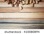 wine corks on wooden background | Shutterstock . vector #410080894