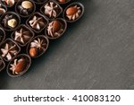 chocolate sweets on wooden... | Shutterstock . vector #410083120