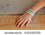 Child Wears Bracelets On His...