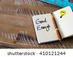 Small photo of Conceptual Business Acronym GE Good Enough. Retro effect and toned image of a fountain pen on a notebook