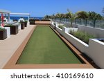 Upscale artificial turf bocce ball court on an outdoor oceanfront terrace. - stock photo
