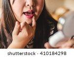young beautiful woman making... | Shutterstock . vector #410184298