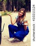 female mechanic changing tire... | Shutterstock . vector #410211124