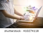 young woman typing earned media ... | Shutterstock . vector #410274118