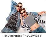fashion couple in sunglasses... | Shutterstock . vector #410294356