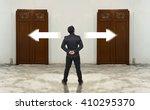 Businessman Standing In Doubt...