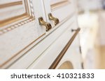 Stock photo golden furniture handle on white wooden kitchen cabinet small depth of field used as background 410321833