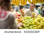Salesman Offers An Apple At...