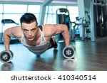 man doing push up holding...   Shutterstock . vector #410340514