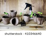 gardener hand sprout table | Shutterstock . vector #410346640