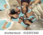group of friends on the beach...   Shutterstock . vector #410351560