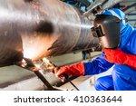 welder in factory welding metal ... | Shutterstock . vector #410363644
