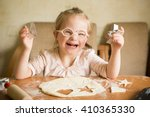 happy girl with down syndrome... | Shutterstock . vector #410365330