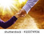 the parent holds the hand of a... | Shutterstock . vector #410374936