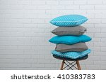 Colorful Pillows On Chair  On...