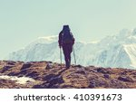 hiker in himalayas mountain.... | Shutterstock . vector #410391673