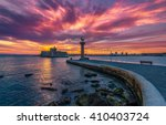 Small photo of Colorful sunrise in Mandaki Harbor Rhodes, Greece