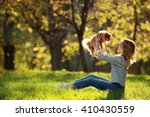 Stock photo girl with a small dog in the park spitz 410430559