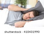 one man trying to sleep... | Shutterstock . vector #410431990