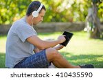 young man relaxing with a... | Shutterstock . vector #410435590