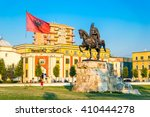 Small photo of Skanderbeg square with flag, Skanderbeg monument and The Et'hem Bey Mosque in the center of Tirana city, Albania.