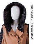 brown coat with quilted hood.... | Shutterstock . vector #410450188