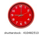 red wall clock isolated on...