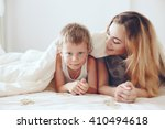 young mother with her 6 years... | Shutterstock . vector #410494618