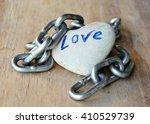 iron chain roll over heart rock ... | Shutterstock . vector #410529739