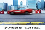 taxi driving on urban road... | Shutterstock . vector #410554588