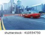 taxi driving on urban road... | Shutterstock . vector #410554750