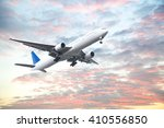 Small photo of Aeroplane flying in sunset sky with beautiful cloud