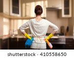 Young Woman Preparing To Clean...