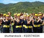 Small photo of Ba'kelalan, Malaysia - 12 Jun 2015 : Kelabit people with their traditional dress playing flute as part of their welcoming culture. Ba'kelalan is a group of villages in the Bario Highlands of Sarawak.
