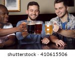 group of happy friends drinking ... | Shutterstock . vector #410615506