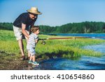 Little Boy Fishing With...