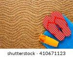 flip flops  sunscreen spray and ... | Shutterstock . vector #410671123