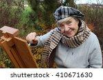 Happy Senior Woman Painting...