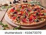 fresh pizza on wood | Shutterstock . vector #410673370