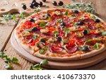 fresh pizza on wood | Shutterstock . vector #410673370