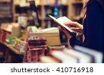 reading a book   Shutterstock . vector #410716918