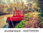 house boat in red at the canal. ...