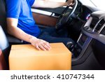 delivery man driving a truck... | Shutterstock . vector #410747344