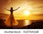 calm woman meditating on sunset ... | Shutterstock . vector #410764168