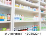 medicines arranged on shelves... | Shutterstock . vector #410802244