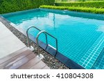 hotel swimming pool with sunny... | Shutterstock . vector #410804308