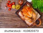 baked chicken with a golden... | Shutterstock . vector #410820373
