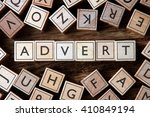 Small photo of the word of ADVERT on building blocks concept