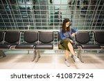 beautiful asian girl looking at ... | Shutterstock . vector #410872924